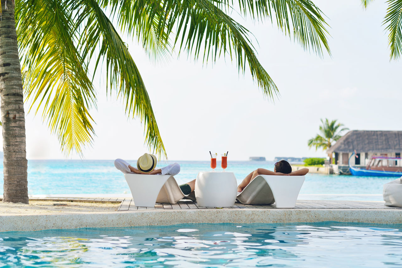 travel-beach-pool-couple