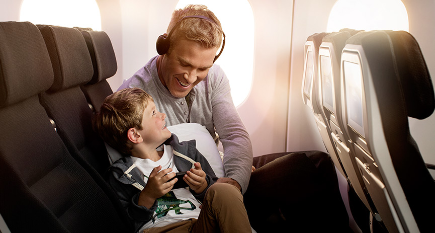 sq-lh-787-9-economy-skycouch-dad-son-865x463